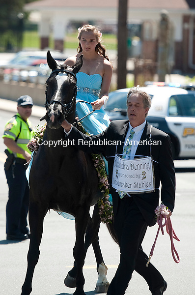 WINSTED, CT--061315JS05- Laurel Queen candidate Alexandra Denning, sponsored by Shoemaker Stables, rides her horse Sadie, with the help of her father Chip Denning during the 2015 Laurel Festival Parade and ceremonies down Main Street in Winsted on Saturday.<br /> Jim Shannon Republican-American