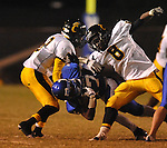 Water Valley's K.J. Lee (17) is tackled vs. Charleston in Water Valley, Miss.  on Friday, September 16, 2011.