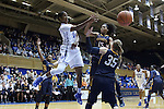 23 November 2014: Duke's Ka'lia Johnson (left) threads a pass between Marquette's Kenisha Bell (15) and Cristina Bigica (ROM) (35). The Duke University Blue Devils hosted the Marquette University Golden Eagles at Cameron Indoor Stadium in Durham, North Carolina in a 2014-15 NCAA Division I Women's Basketball game. Duke won the game 83-51.
