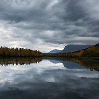 River reflection of mountain landscape near STF Kvikkjokk Fjällstation, Kungsleden trail, Lapland, Sweden