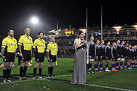 An anthem singer performs prior to the match. Remembrance Rugby match, between Bath United and UK Armed Forces on November 9, 2015 at the Recreation Ground in Bath, England. Photo by: Patrick Khachfe / Onside Images