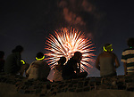 Children sitting on a statue watching the Independence Day Fireworks display at  Waryas Park in Poughkeepsie, NY on Monday, July 4, 2011. Photo by Jim Peppler. Copyright © Jim Peppler 2011.