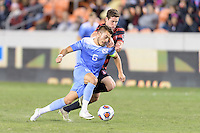 Houston, TX - Friday December 9, 2016: Colton Storm (6) of the North Carolina Tar Heels and Foster Langsdorf (2) of the Stanford Cardinal battle for control of the ball at the NCAA Men's Soccer Semifinals at BBVA Compass Stadium in Houston Texas.