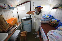 Babadag. The couple Andrei and Laura Stefania, from Pitesti to the north of Bucharest, in the middle of harvesting in their caravan. They are professional beekeepers and tell me that they sell their honey in Germany. They keep apart from the community formed by the other beekeepers because they own a car. Laura Stefania in the neat and tidy cab, plies the extractor while her husband opens the hives to take out the frames full of honey.