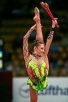 """Evgenia Kanaeva of Russia balances with clubs at 2008 World Cup Kiev, """"Deriugina Cup"""" in Kiev, Ukraine on March 22, 2008."""