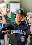 28 August 2016: Colorado Rockies outfielder Carlos Gonzalez is greeted in the dugout after coming home to score in the 3rd inning against the Washington Nationals at Nationals Park in Washington, DC. The Rockies defeated the Nationals 5-3 to take the rubber match of their 3-game series. Mandatory Credit: Ed Wolfstein Photo *** RAW (NEF) Image File Available ***