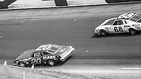 Rick Newsom, #20 Oldsmobile, Chuck Bown, #68 Buick, 1979 Firecracker 400 NASCAR race, Daytona International Speedway, Daytona Beach, FL, July 4, 1979.  (Photo by Brian Cleary/ www.bcpix.com )