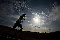 CAPTION-ONLY PHOTO: Erik Sorenson of Farmington runs the half-marathon as he participates in the Hess Cancer Legacy Parkway Bike & Run in Davis County. The Hess Cancer Foundation (HCF) is hosted a Half-Marathon, 20-Mile Bike Tour, and 2-Mile Fun Run from 8 a.m. to 1 p.m. Registrations and donations will benefit families that have lost children to cancer and struggle to find money to pay for funerals. The foundation works very closely with Primary Children's Hospital to find local families in need. Saturday, Aug. 29, 2009. August Miller, Deseret News .