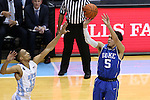 07 March 2015: Duke's Tyus Jones (5) shoots over North Carolina's J.P. Tokoto (13). The University of North Carolina Tar Heels played the Duke University Blue Devils in an NCAA Division I Men's basketball game at the Dean E. Smith Center in Chapel Hill, North Carolina. Duke won the game 84-77.