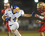 Oxford High's Toler Presley (14) catches a pass as Lafayette High's Colby Terrell (10) defends at William L. Buford Stadium in Oxford, Miss. on Friday, September 2, 2011. Lafayette won 40-12