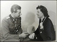 BNPS.co.uk (01202 558833)<br /> Pic: Marlows/BNPS<br /> <br /> Gretl Braun with new husband Hermann Fegelein.<br /> <br /> Taken just three days before D-Day this remarkable photo shows Adolf Hitler celebrating the wedding of his brother-in-law - who he had executed a year later.<br /> <br /> The previously unseen image shows the Nazi dictator congratulating Hermann Fegelein and bride Gretl Braun, little realising that the course of the Second World War was about to turn against him.<br /> <br /> It was found in a gallery of 12 snaps of the wedding reception that lasted for thee days and was organised by Eva Braun, the elder sister of Gretl and Hitler's mistress.<br /> <br /> The fuhrer was one of the witnesses to the marriage along with SS chief Heinrich Himmler and Martin Bormann, Hitler's private secretary.<br /> <br /> The 12 black and white photos taken at her first wedding have sold at Marlows auctioneers of Stafford for &pound;400.