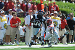 Ole Miss running back Brandon Bolden (34) is chased by Jacksonville State linebacker Antonio Bonner (54) at Vaught-Hemingway Stadium in Oxford, Miss. on Saturday, September 4, 2010.