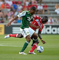 Chicago forward Dominic Oduro (8) battles for the ball with Portland midfielder Darlington Nagbe (6).  The Portland Timbers defeated the Chicago Fire 1-0 at Toyota Park in Bridgeview, IL on July 16, 2011.