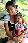 South America, Brazil, Amazon. A very young mother raising her baby for life on the Amazon.