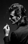 Denver Colorado<br /> USA<br /> 1983<br /> <br /> Willy DeVille (August 25, 1950 - August 6, 2009) was an American singer and songwriter. First with his band Mink DeVille (1974-1986) and later on his own, DeVille in his 35-year career created songs that are wholly original yet rooted in traditional American musical styles. <br /> <br /> DeVille worked with collaborators from across the spectrum of contemporary music, including Jack Nitzsche, Doc Pomus, Dr. John, Mark Knopfler, Allen Toussaint, and Eddie Bo. The typical DeVille song--if any of his songs can be called &quot;typical&quot;--is filled with romantic conviction and yearning. Latin rhythms, blues riffs, doo-wop, Cajun music, strains of French cabaret, and echoes of early-1960s uptown soul can be heard in DeVille's work.<br /> <br /> Mink DeVille was a house band at CBGB, the historic New York City nightclub where punk rock was born in the mid-1970s.