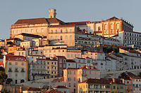 View of the medieval city of Coimbra, with the University of Coimbra at the summit, with its clock tower and General Library, Coimbra, Portugal. The University of Coimbra was first founded in 1290 and moved to Coimbra in 1308 and to the royal palace in 1537. The city dates back to Roman times and was the capital of Portugal from 1131 to 1255. Its historic buildings are listed as a UNESCO World Heritage Site. Picture by Manuel Cohen University of Coimbra, Coimbra University, university, clock tower, library, General Library