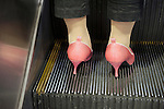 _SAM0105, British Airways, Tokyo, Japan, JAPAN-10149. A woman wears pink pumps.<br />