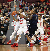 Ohio State's Lenzelle Smith, Jr. (32) and Amir Williams (23) battle North Florida's Travis Wallace (1) for a rebound during the first half Friday, Nov. 29, 2013, in Columbus, Ohio. (Photo by Terry Gilliam)