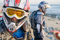 Smiling motorcycle rider on beach in Mexio