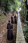 Camino, Italy, September, 2004, ITALY-10020. Monks walk down path. <br />