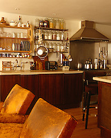 The hardwood kitchen cabinets of this cosy London kitchen were handmade in Vietnam