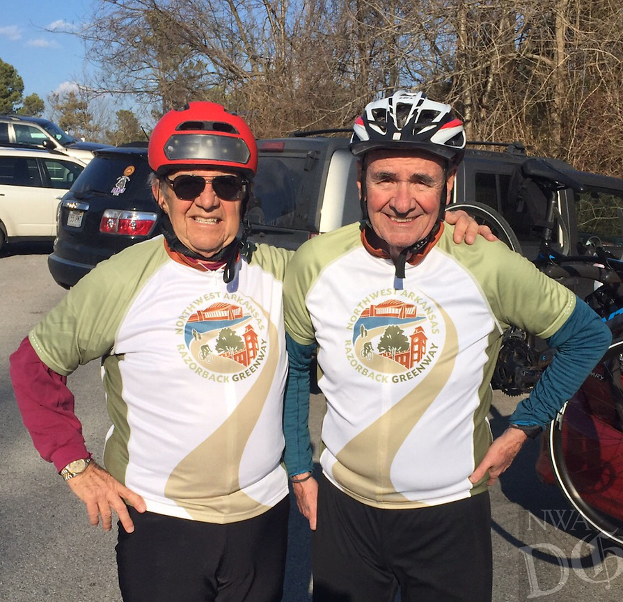 Courtesy photo<br /> Bill Kennedy (left) and Dan Ferritor sport Razorback Greenway jerseys after Kennedy's 75-mile bike ride on his 75th birtday. Ferritor rode 76 miles on his 76th in November and joined Kennedy for his birthday ride in February.