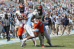 19 September 2015: Illinois Geronimo Allison (8) is tackled by UNC's Jeff Schoettmer (10). The University of North Carolina Tar Heels hosted the University of Illinois Fighting Illini at Kenan Memorial Stadium in Chapel Hill, North Carolina in a 2015 NCAA Division I College Football game. UNC won the game 48-14.