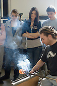 Secondary School students on an Aim Higher day see how to handle very hot glass, University College for the Creative Arts, Farnham.