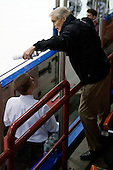 Tim Army (Providence - Head Coach) talks to USA Hockey's Tim Taylor during warmups. - The Northeastern University Huskies defeated the visiting Providence College Friars 5-0 on Saturday, November 20, 2010, at Matthews Arena in Boston, Massachusetts.