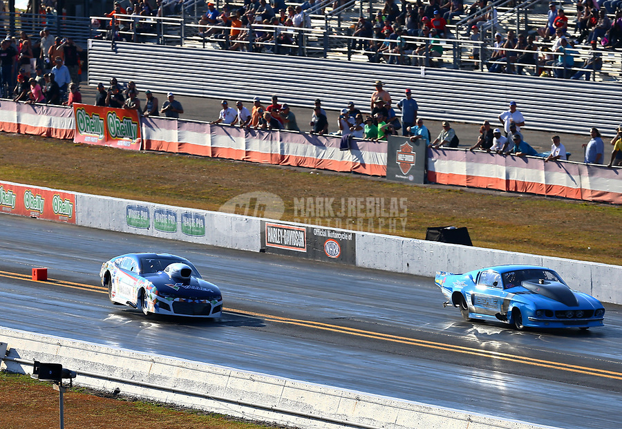 Mar 18, 2017; Gainesville , FL, USA; NHRA pro mod driver Rickie Smith (left) goes sideways on two wheels against Michael Biehle during the Gatornationals at Gainesville Raceway. Mandatory Credit: Mark J. Rebilas-USA TODAY Sports