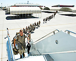 Marines from attack Squadron-513 begin to board there plane Thursday morning at Marine Corps Air Station. Marines from VMA-513 and Marine Aviation Logistics Squadron 13 are participating in a six month deployment in support of the 31st Marine Expeditionary Unit, based in Japan.