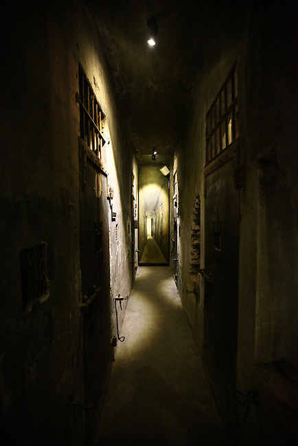 """Individual isolation cells line a dim corridor inside the former Hoa Lo prison in Hanoi, Vietnam. Known as the """"Hanoi Hilton"""" to U.S. pilots held there after being shot down during the Vietnam War, most of the structure was demolished after the conflict ended. The museum  focuses primarily on the brutal conditions under which Vietnamese political prisoners were held during the French colonial era. Oct. 27, 2012."""