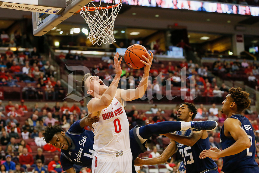 Ohio State Buckeyes center Micah Potter (0) is fouled by Jackson State Tigers forward Derek Roscoe (4) during the first half of The Ohio State University's game against Jackson State University at the Schottenstein Center on the evening of Wednesday, November 23, 2016. (Dispatch photo by Tyler Stabile)