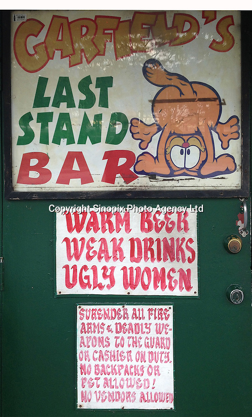 A humourous sign is seen on the door of a girly bar in Angeles City, Republic of the Philippines, 08 November 2014. The 'sin city', which sprung up on the fringes of a US Air Force base during the Vietnam war, has a reputation for cheap sex, and was a favourite destination for alleged murderer Rurik Jutting, who used to fly to Angeles City from Hong Kong for debauched weekends. The British banker is currently on remand at a secure facility in Hong Kong for allegedly murdering two Indonesian prostitutes in his flat whilst high on alcohol and cocaine.