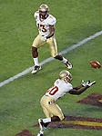 Florida State safety Lamarcus Joyner (20) makes an interception in the end zone in the first quarter.