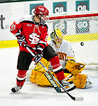 12 December 2009: St. Lawrence University Saints' forward Brandon Bollig, a Sophomore from St. Charles, MO, watches a shot deflect wide against the University of Vermont Catamounts at Gutterson Fieldhouse in Burlington, Vermont. The Catamounts shut out their former ECAC rival Saints 3-0. Mandatory Credit: Ed Wolfstein Photo