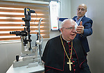 Bishop William Murphy of Rockville Centre gets his vision checked by Dr. Jamell Nickoly Chico, an optometrist, in the Mar Narsai Clinic in Dahuk, Iraq, on April 10, 2016. The clinic was built and equipped by the Catholic Near East Welfare Association--of which Bishop Murphy is a member of the board--to meet the needs of Christians and others displaced to Dahuk because of attacks by ISIS.<br /> <br /> Bishop Murphy came to northern Iraq with Cardinal Timothy Dolan, the archbishop of New York and chair of CNEWA, and other church leaders to visit with Christians and others affected by ISIS. <br /> <br /> CNEWA is a papal agency providing humanitarian and pastoral support to the church and people in the region.