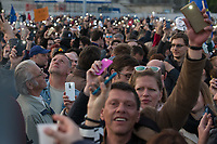 People who participate light with their mobile phones during a demonstration to support civil society in Budapest, Hungary on April 12, 2017. ATTILA VOLGYI