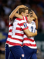 PORTLAND, Ore. - July 9, 2013: Stuart Holden and Landon Donovan embrace after Holden's goal in the second half. The US Men's National team plays the National team of Belize during the 2013 Gold Cup at at JELD-WEN Field.