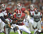 Ole Miss defensive back Quintavius Burdette (2) vs. Alabama running back Eddie Lacy (42) at Bryant-Denny Stadium in Tuscaloosa, Ala. on Saturday, September 29, 2012.