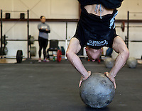 Cody Jamison does a handstand pushup on an atlas stone at Progressive Fitness CrossFit. Crossfit image, picture, photo, photography of health, elite, exercise, training, workouts, WODs, taken at Progressive Fitness CrossFit,Colorado Springs, Colorado, USA