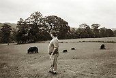 Garrett, Pennsylvania.July 7, 2003..Randy Fogle, the only one of the nine miners rescued last year to return to the mine, gazes across his front lawn...