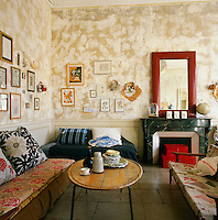 The living room has an eclectic feel with a distressed finish on the walls and retro style furniture