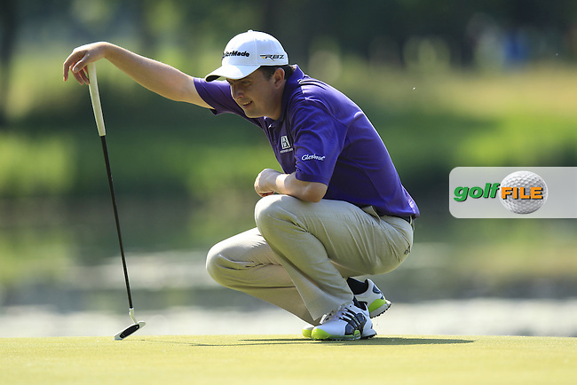 Peter Lawrie (IRL) lines up his putt on the 16th green during Thursday's Round 1 of the 2013 BMW International Open held on the Eichenried Golf Club, Munich, Germany. 20th June 2013<br /> (Picture: Eoin Clarke www.golffile.ie)