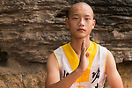 Young Shaolin martial arts school student artistic portrait in DengFeng, Henan, China 2014