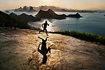 SAM_4570, Rio de Janeiro, Brazil, 2/2009, BRAZIL-10010NF. A man running.<br /> <br /> <br /> final print_Genoa<br /> retouched_Sonny Fabbri<br /> MAX PRINT SIZE: 40X60