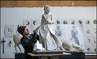BNPS.co.uk (01202 558833)<br /> Pic: PhilYeomans/BNPS<br /> <br /> The first ever statue of literary heroine Jane Austen takes shape in the studio of Hampshire artist Adam Roud - nearly 200 years after her death.<br /> <br /> The half size macquette shows the English novelist clutching a book to her heart and in a flowing coat as she strides through the town square of old Basingstoke.<br /> <br /> Adam is now working on a life size version of the macquette that will be cast in bronze and unveiled in the Hampshire town this summer on the 200th anniversary of her death on 18th July 1817.<br /> <br /> Only one portrait of Austen, painted by her sister Cassandra, exist's as she achieved little fame during her lifetime.<br /> <br /> The life size bronze will create a long overdue monument to one of Britains greatest novelists.