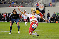 Stephen Keel (22) of the New York Red Bulls plays the ball as Chad Barrett (11) of the Los Angeles Galaxy looks on. The New York Red Bulls defeated the Los Angeles Galaxy 2-0 during a Major League Soccer (MLS) match at Red Bull Arena in Harrison, NJ, on October 4, 2011.