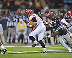 Louisiana-Lafayette's Brad McGuire (8)  is chased by Ole Miss linebacker Mike Marry (52) in Oxford, Miss. on Saturday, November 6, 2010. Ole Miss won 43-21.