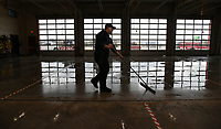 NWA Democrat-Gazette/ANDY SHUPE<br /> Andrew Patton, a firefighter at Farmington Fire Department, uses a Friday, March 17, 2017, to clean the floors of the fire station in preparation for today's pancake breakfast. The breakfast is from 6-10 a.m. and raises money for the purchase of new firefighting equipment.